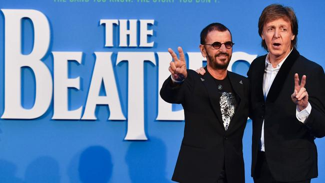 """Britain singer-songwriter Paul McCartney (R) and muscian Ringo Starr (L) of legendary rock-band The Beatles pose arriving on the carpet to attend a special screening of the film """"The Beatles Eight Days A Week: The Touring Years"""" in London on September 15, 2016. / AFP PHOTO / Ben STANSALL"""