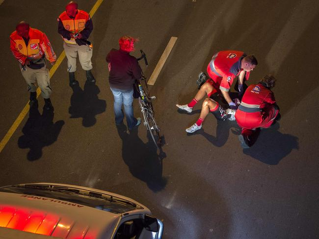 One of the early riders is treated for injuries before the event was cancelled.Picture: AFP/Rodger Bosch