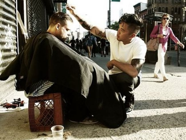 Helping hand ... Mark Bustos cuts hair for the homeless every Sunday.