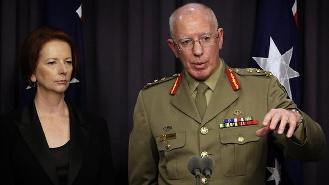 General David Hurley, with Prime Minister Julia Gillard, names the two Australian soldiers killed in a helicopter crash in Afghanistan. Picture: Ray Strange