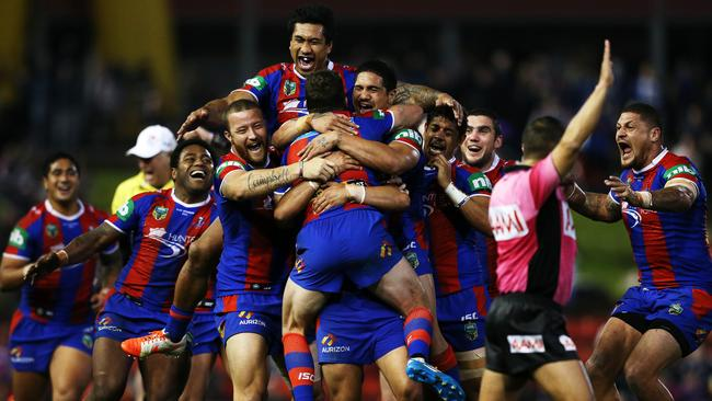 The Knights celebrate after snatching victory at the death against the Storm. .
