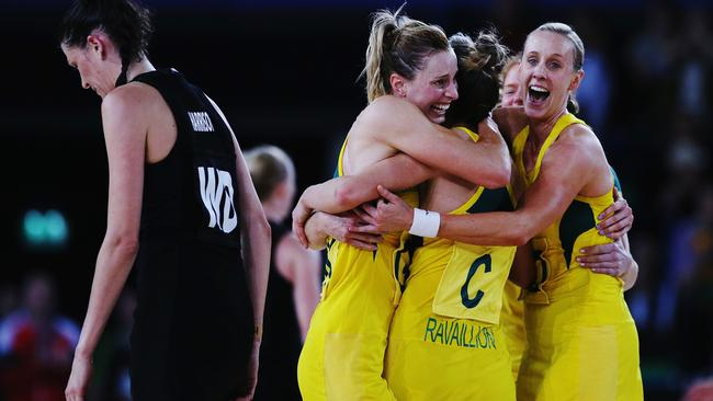 Laura Geitz, Kim Ravaillion and Renae Hallinan celebrate winning the 2014 Commonwealth Games gold medal in Glasgow.