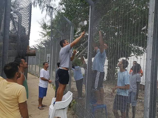 Refugees secure a recently damaged perimeter fence at the Manus Island immigration detention centre as they prepare to barricade themselves inside. Picture: AAP Image/Refugee Action Coalition