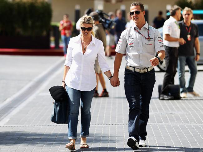 Michael Schumacher walks with wife Corrina in Abu Dhabi in 2011.