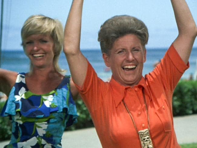 "Florence Henderson as Carol Brady and Ann B. Davis as Alice in The Brady Bunch episode ""Hawaii Bound"" which aired in September 1972."