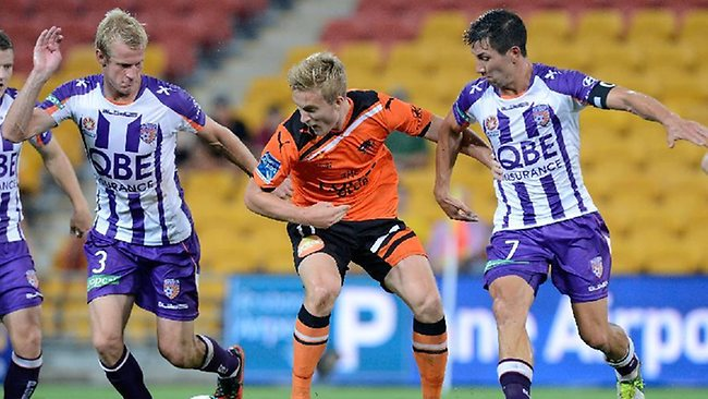 HEAT IS ON: Brisbane Roar's Ben Halloran comes under pressure from Perth Glory's Jacob Burns (right) and Bas Van den Brink during the sides' meeting last month. Picture: Getty Images