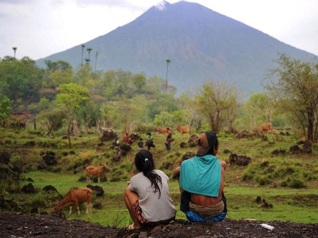 Villagers look at the Mount Agung volcano from Kubu in Bali. Picture: AFP/Sonny Tumbelaka
