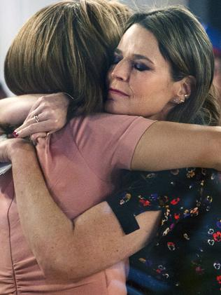 Savannah Guthrie hugs Hoda Kotb after they announce Matt Lauer's departure. Picture: AP