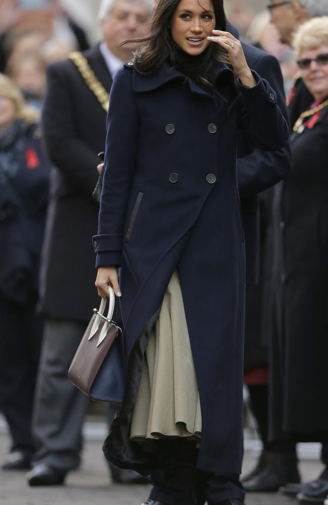 Meghan Markle wore a long skirt and woollen coat in her first official day on the job. Picture: AP/Photo/Alastair Grant.