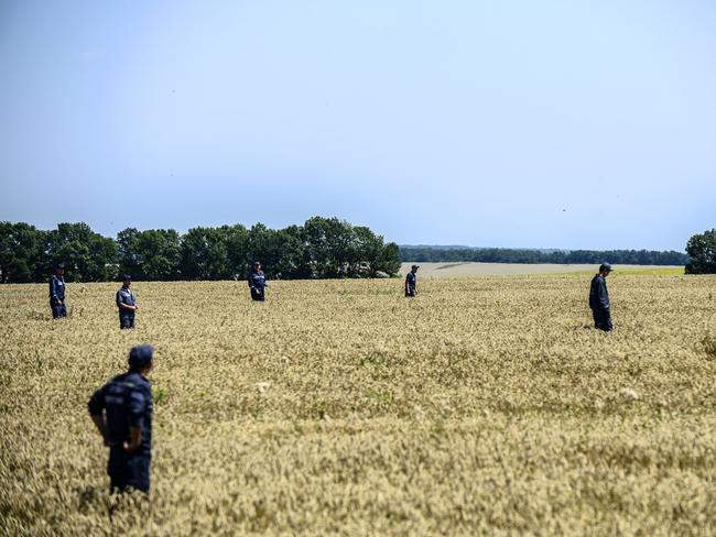 Long search ... members of the Ukrainian State Emergency Service search for bodies in a field near the crash site of the Malaysia Airlines Flight MH17 near the village of Hrabove (Grabovo), in Donetsk region.