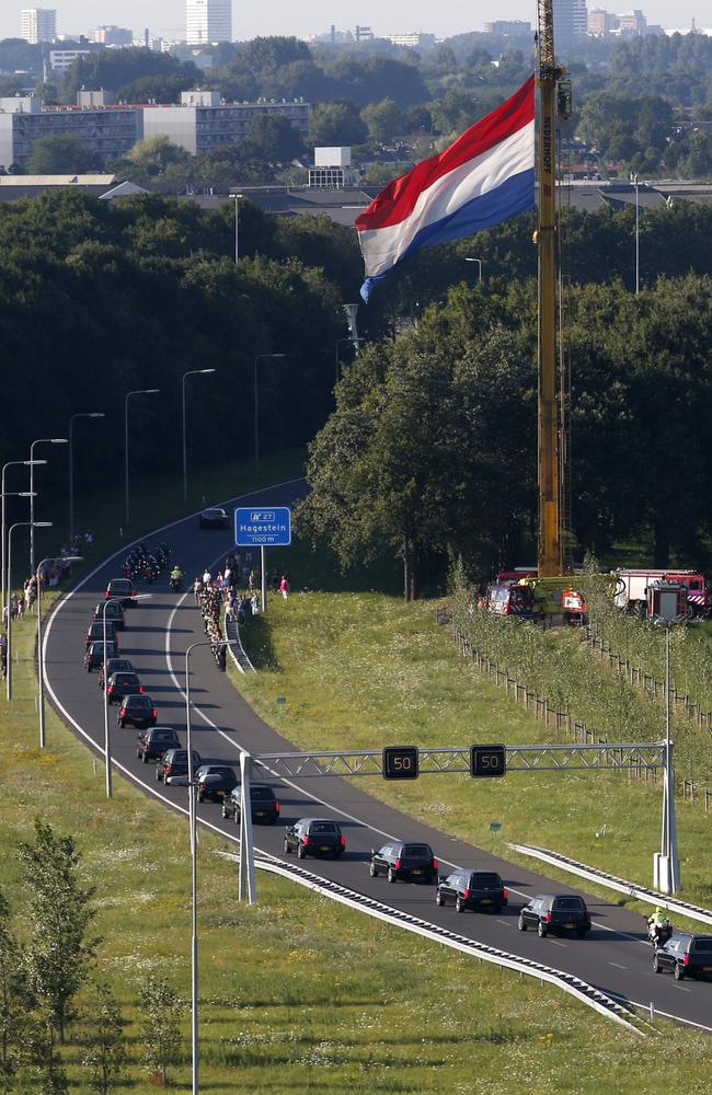 The convoy of funeral hearses carrying coffins containing the remains of victims of MH17 drives from the Eindhoven Airbase to Hilversum in the Netherlands / Picture: AFP