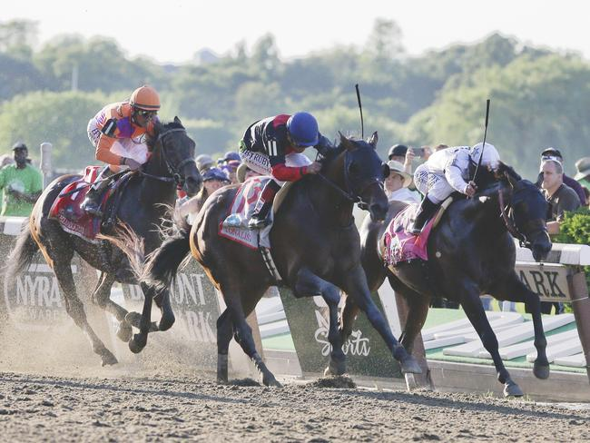 Tonalist (centre), with Joel Rosario up, beats Commissioner (right), with Javier Castellano in the saddle, to win the Belmont Stakes. Picture: AP