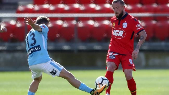 Stefan Mauk took on his former club in a trial game last month, taking on Reds recruit Daniel Adlung. Picture: Calum Robertson