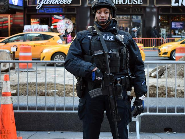A New York Police Department officer patrols in Times Square. Picture: AFP/PHOTO / Jewel SAMAD