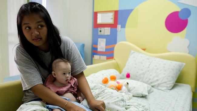 "Thai surrogate mother Pattaramon Chanbua holds her baby Gammy. She has been described as a ""saint"" and ""absolute hero"" by Australian Immigration Minister Scott Morrison. Picture: AFP"