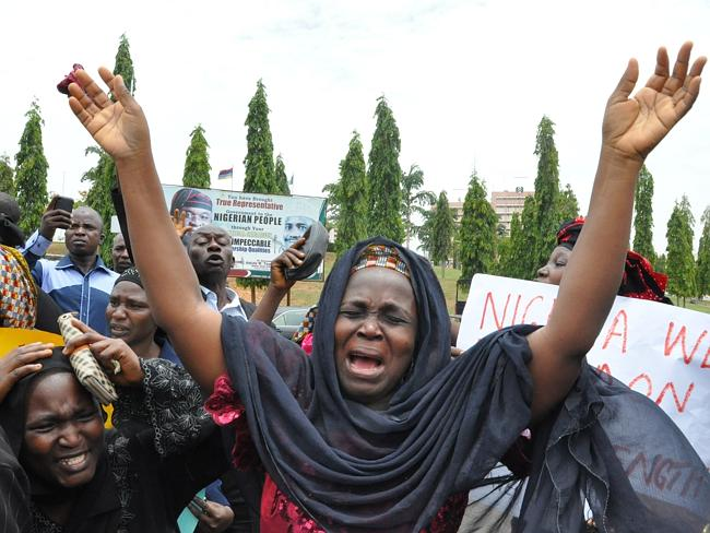 Calling for their freedom ... a mother cries out during a demonstration with others who h