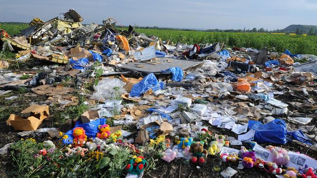 Heartache ... flowers and toys are left at the site of the crash.