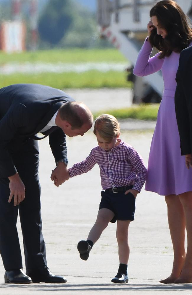 Even Prince George's shirt matches his mother's purple frock. Picture: AFP
