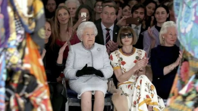 Britain's Queen Elizabeth, second left, sits next to fashion editor Anna Wintour, third left, and Caroline Rush, chief executive of the British Fashion Council (BFC), left, as they view Richard Quinn's runway show. Picture: APSource:AP