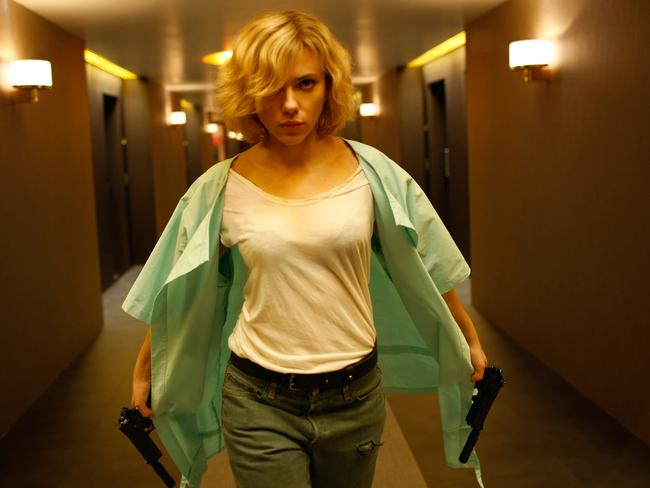 Johansson escapes her captors in a scene from Luc Besson's  <i>Lucy</i>.
