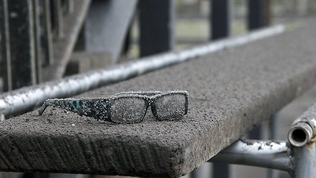 A pair of forgotten glasses are covered in ash. Picture: Hagen Hopkins