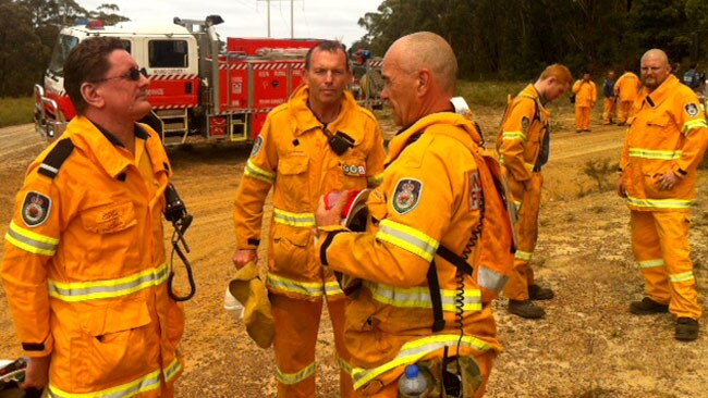 Opposition Leader Tony Abbott preparing to going into fire ground for backburning and hazard reduction.