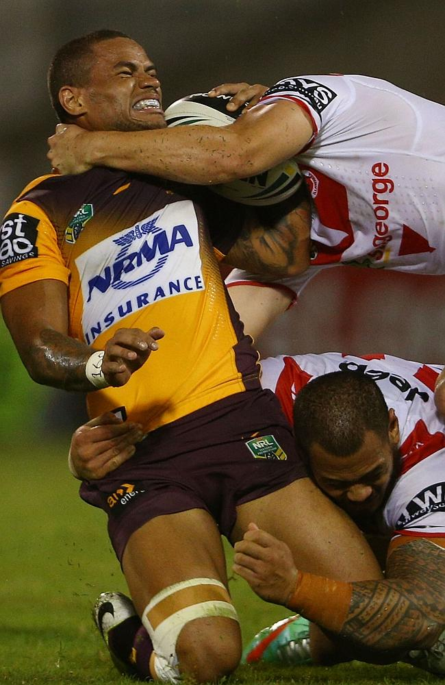 Josh Hoffman is tackled by Leeson Ah Mau from the Dragons.
