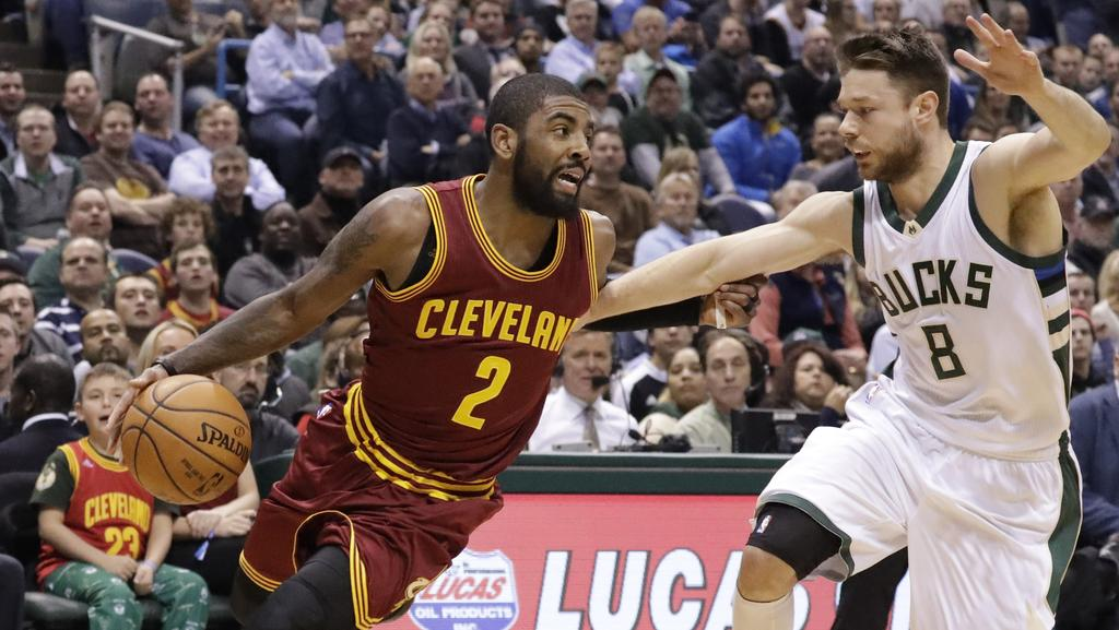Cleveland Cavaliers' Kyrie Irving drives past Milwaukee Bucks' Matthew Dellavedova.