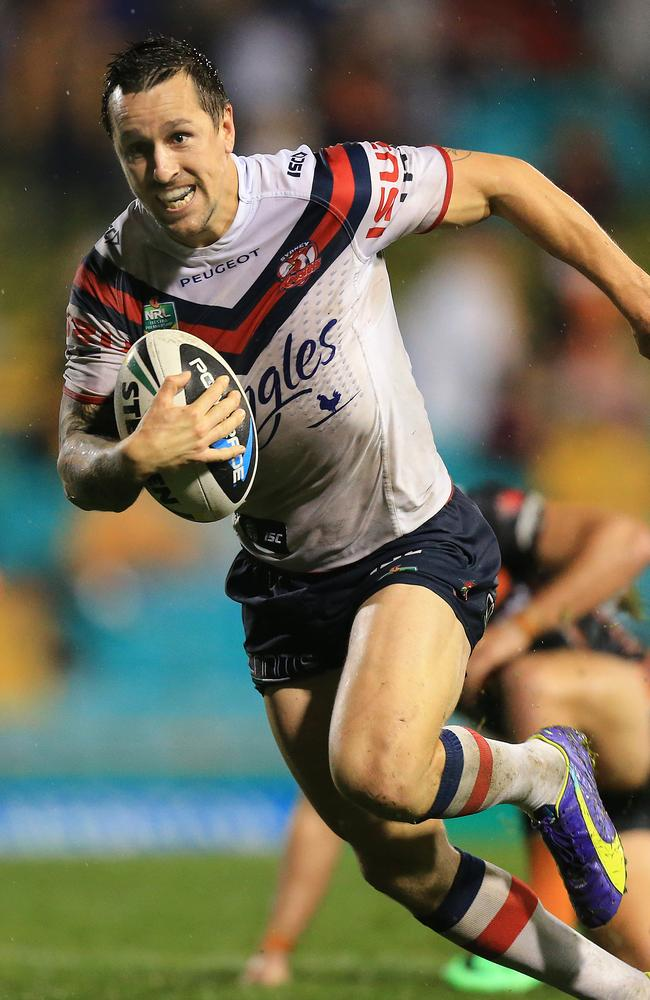 Mitchell Pearce goes over to score for the Roosters.