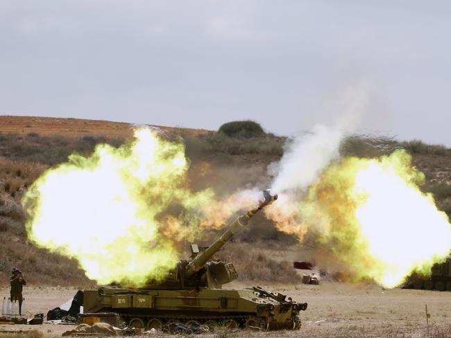 Battle rages ... An Israeli army US made self-propelled howitzer 155m cannon fires a shell from the Israel-Gaza border.
