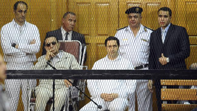 Dictator ... former Egyptian president Hosni Mubarak, in wheelchair, on trial in Cairo with his two sons, Gamal and Alaa Mubarak.