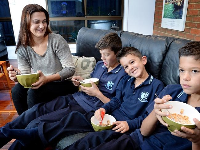 Less than ideal ... Katina Simos and her three sons Thomas Simos, 12, Phoenix Simos, 5, and Dean Simos, 10 often find themselves eating breakfast in front of the TV at their Rowville home. Picture: Nicole Garmston