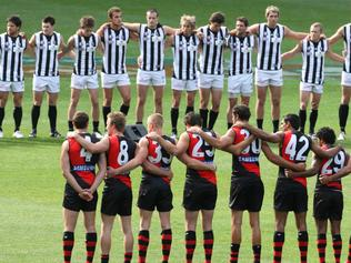 Essendon v Collingwood. MCG. 2009 Anzac Day. Players unite before the match. Line up.
