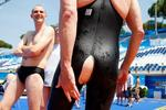 <p>Reuters correspondent Ian Simpson dives into the aquatic World Championships competition pool with a ripped Jaked 01 full body all-polyurethane swimsuit in Rome July 30, 2009. To get the inside story on the controversial suits that are the stars of the world swimming championships, you have to get inside one. You had better have plenty of time, however, because inching on this synthetic second skin for a swim in the world championship pool was a sweaty workout for this Reuters correspondent.</p>