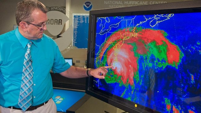 National Hurricane Center Director Bill Read points to the landfall of Hurricane Irene's eye at Cape Lookout. Picture: Andy Newman / AP