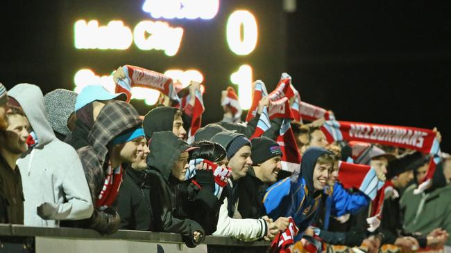 Supporters watch from the crowd during a freezing night in Ballarat.