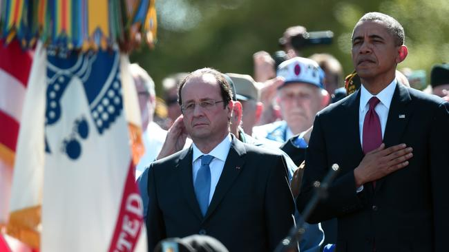 Coming together ... US President Barack Obama and French President Francois Hollande stand during a joint French-US D-Day commemoration ceremony at the Normandy American Cemetery and Memorial. Picture: Damian Meyer