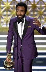 """Donald Glover accepts the award for outstanding directing for a comedy series for the """"Atlanta"""" episode """"B.A.N."""" at the 69th Primetime Emmy Awards on Sunday, Sept. 17, 2017, at the Microsoft Theater in Los Angeles. Picture: AP"""