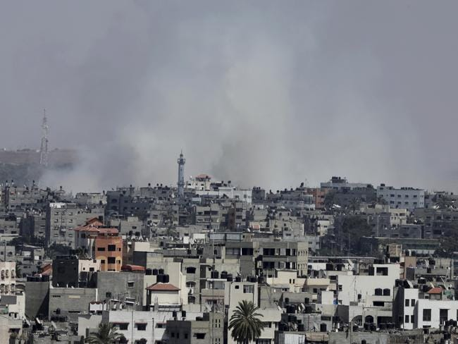Go west ... Smoke rises after an Israeli missile strike in Gaza City.