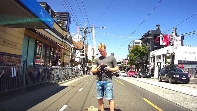 The skateboarder takes an image of the car's numberplate, which is captured on dashcam. Picture: Dash Cam Owners Australia.