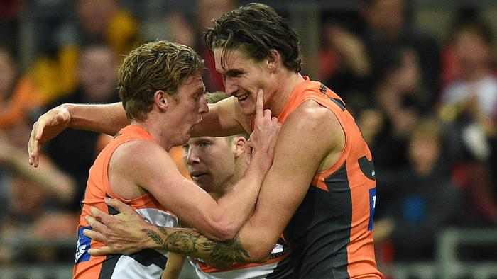 Rory Lobb of the Giants, (right), celebrates with team mates after kicking a goal during the round 21 AFL match between the Greater Western Sydney (GWS) Giants and the West Coast Eagles at Spotless Stadium in Sydney, Saturday, Aug. 13, 2016. (AAP Image/Dan Himbrechts) NO ARCHIVING, EDITORIAL USE ONLY