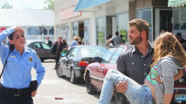 UNDER THE DOME, Pictured L-R: Natalie Martinez as Deputy Linda, Britt Robertson as Angie and Mike Vogel as Barbie. Picture: Supplied
