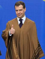 Russia's President Dmitry Medvedev gives the thumbs for the poncho.