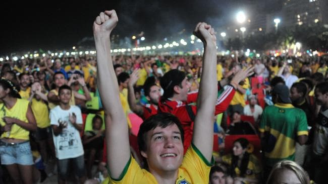 A fan of Brazil celebrates during the Fan Fest at Copacabana beach in Rio de Janeiro, Brazil.