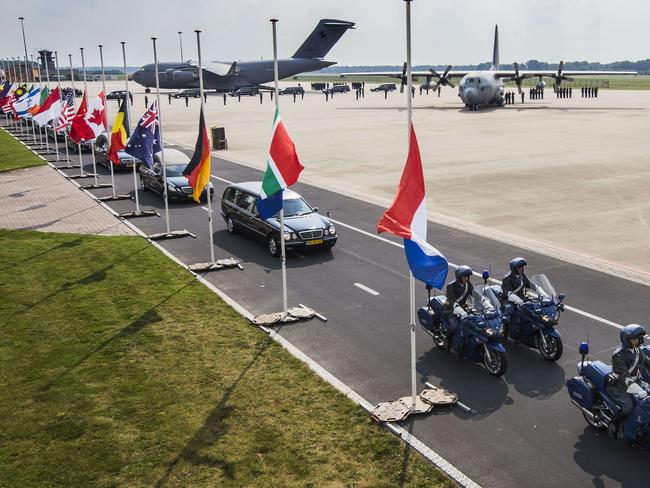 Bodies back ... Hearses carrying the coffins with the remains of the victims of the Malaysian Airlines MH17 plane crash leave Eindhoven military airport.