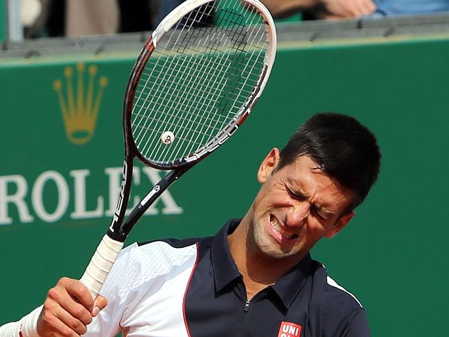 Novak Djokovic of Serbia reacts after losing a point against Roger Federer.