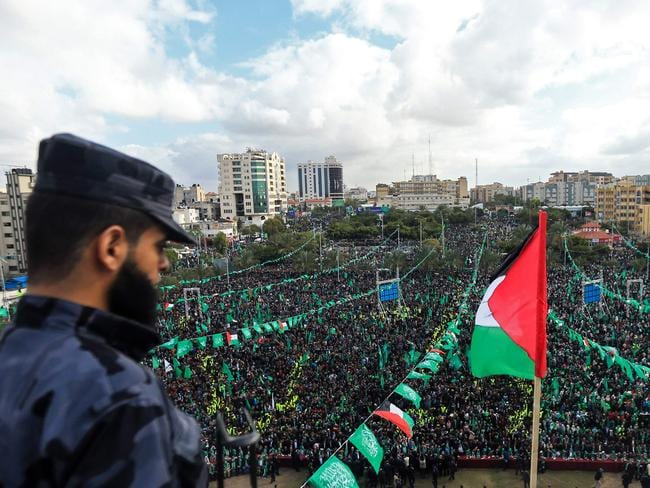 Hamas supporters take part in a rally marking the 30th anniversary of the founding of the Islamist movement, in Gaza City.