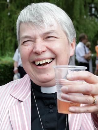 Here's cheers ... Reverend Canon Joyce Jones of Wakefield celebrates with a drink. Picture: Lindsey Parnaby