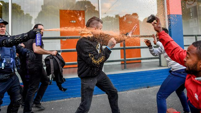 Police were forced to use capsicum spray on violent protesters. Picture: Jake Nowakowski