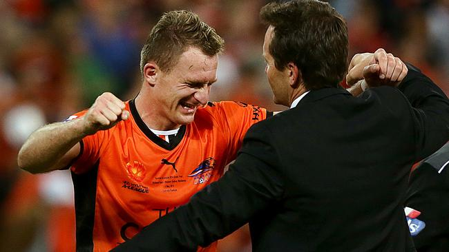 Besart Berisha with Mike Mulvey after the Roar's grand final win last season.